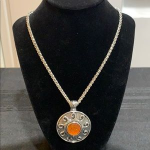 NWT Silver toned necklace/pendant orange sun